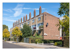 The Built Environment, East London, England. (Joseph O'Malley64) Tags: thebuiltenvironment newtopography newtopographics manmadeenvironment manmadestructures buildings structures eastlondon eastend london england uk britain british greatbritain blocksofflats flats housingestate councilestate estate highdensityhousing housing homes dwellings abodes postwarhousing brickwork bricksmortar cement pointing steelreinforcedconcretestructures chimneys chimneypots tvaerials antenna zincflashing tiledroof roofingtiles satellitedishes wiring electricalwiring junctionboxes sign signage lamp lighting balconies trees shrubs bushes hedging bollards fencing pavement concrete accesscovers granitekerbing tarmac singleyellowline parkingrestrictions architecture architecturalfeatures architecturalphotography documentaryphotography britishdocumentaryphotography colour urban urbanlandscape fujix fujix100t accuracyprecision
