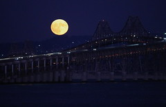 Full moon rising over the San Francisco Bay (Robin Wechsler) Tags: moon fullmoon harvestmoon moonrising bridge architecture water sanfranciscobay weather nature night dusk fullmoonrising landscape seascape outside sky