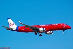 VIRGIN BLUE ERJ190 VH-ZPL (Adrian.Kissane) Tags: airline airliner jet plane aircraft aeroplane flight flying australia arriving sky outdoors 1212009 vhzpl melbourne erj190 virginblue