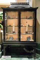 Display case of antique Chinese art work (thewanderingeater) Tags: windsorcourthotel neworleans luxuryboutiquehotel centralbusinessdistrict louisiana luxuryhotel