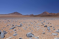 Alone (Joost10000) Tags: bolivia andes mountains altiplano highlands stones desert siloli wild wilderness dry outdoors nature natur canon eos canoneos5d southamerica south america national reserve eduardoavaroa rocks