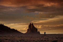 Lone photographer with tripod taking photos of the storm clouds at sunset over Shiprock volcanic rock formation near Shiprock, New Mexico (diana_robinson) Tags: newmexico silhouette tripod navajoland monadnock shiprock sanjuancounty navajonation nationalnaturallandmark volcanicrockformation shiprockpeak rockwithwings lonephotographer wingedrock tsébit'a'í nikonflickraward abigfave
