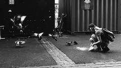 Birds Flying High (Sean Batten) Tags: london england unitedkingdom boroughmarket streetphotography street blackandwhite bw candid person pidgeon fuji fujifilm x100f city urban flying