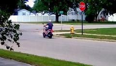 Scooter! - HFF Menominee Michigan (Maenette1) Tags: scooter rider fence neighborhood menominee uppermichigan happyfencefriday flicker365 allthingsmichigan absolutemichigan projectmichigan
