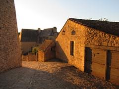 Houses opposite Château de Beynac, last sunlight, Beynac-et-Cazenac, France (Paul McClure DC) Tags: beynacetcazenac périgord dordogne france nouvelleaquitaine sept2019 castle château historic architecture
