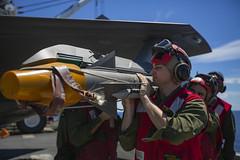 Orides load an A/A missile on to an F-35B (MarineCorpsAviationAssociation) Tags: 31stmarineexpeditionaryunit battalionlandingteam 2ndbattalion 1stmarines combatlogisticsbattalion31 marinemediumtiltrotorsquadron265reinforced commandelement groundcombatelement logisticscombatelement aviationcombatelement iiimarineexpeditionaryforce amphibiousassaultshipusswasplhd1 amphibioustransportdockussgreenbaylpd20 docklandingshipussashlandlsd48 7thfleet 31stmeu blt21 clb31 vmm265rein iiimef lhd1 lpd20 lsd48 okinawa japan marinecorps indopacific ready partnered lethal marineairgroundtaskforce magtf mv22bospreytiltrotoraircraft f35blightningii ch53esuperstallionhelicopter ah1zviperhelicopter uh1yhvenomhelicopter ordnance pacificocean