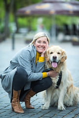 Vilnius- Lithuania, May 6, 2019: Mature Caucasian Female with Her Pale Dog Outdoors in Vilnius, May 6, 2019 (DmitryMorgan) Tags: dog lithuania animal editorial embraced family female friend happy mature outdoors pale pet playful posing puppy smile street together vilnius