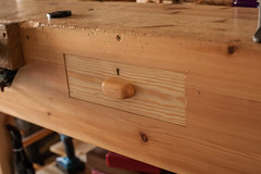 Workbench Drawer with brass lock and handle (btyreman) Tags: wood pine handle 50mm woodwork handmade craft apron drawer brass oldgrowth artsandcraft douglasfir handtools drawerhandle handcarved escutcheon scotspine canoneos5d planart1450 brasslock mortiselock redwoodpine slowgrowth drawermaking woodworking workbench ©bentyreman2019 carlzeiss bulbous