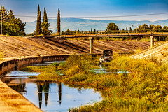 Frejus - It's not all Bikinis and Baguettes (DXW1978) Tags: frejus france reyran drain sewer concrete wreckage mad max dystopia weird strange oddly beautiful water reflection sky mountains landscape