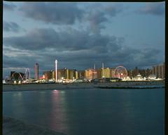 Coney Island Boardwalk (GPhace) Tags: 120mm 2019 coneyisland dinoswonderwheel fujicolorpro400h filmphotography fuji fujifilm lunapark mamiya mediumformat nyc rb67pros shootfilm summer upstatenewyork filmgrain manualfocus tripod