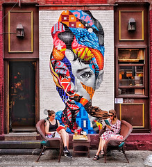 """Little Italy, NYC (RagbagPhotography) Tags: little italy nyc """"new york"""" manhattan girl wall art reading street painting mural comic outdoor audrey hepburn holly golightly mulberry"""