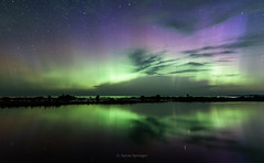 Waawaate (Aaron Springer) Tags: michigan northernmichigan lakemichigan thegreatlakes sleepingbeardunesnationallakeshore platteriver auroraborealis northernlights auroras stars clouds reflection nightsky outdoor nature nightphotography