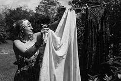 MM4-045-21b (David Swift Photography) Tags: davidswiftphotography laundry hanginglaundry clotheshanging hanginglaundryouttodry candidportrait womensmoking film 35mm nikonfm2 clothesline