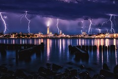 Lightning storm over Antwerp. (Jochem.Herremans) Tags: sky belgium urban illuminated historic harbour lady travel lightningstorm europe cityscape reflection thunder journey dramaticsky evening stormysky tourism schelde civilization skyline lights flemish antwerp antwerpen famous landmark night storm city beautiful ancient water tower scheldt cathedral lightning thunderstorm town church downtown architecture blue port river panorama harbor dark thunderclouds belgian btscritique