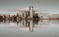 City on the horizon - Ciudad sobre el horizonte (ricardocarmonafdez) Tags: newyork jerseycity skyline buildings arqitectura architecture reflejos reflections processing edition color symmetry simetría sunlight rascacielos skyscrapers horizon nikon d850 24120f4gvr mirror details nubes clouds cielo sky ricardocarmonafdez ricardojcf