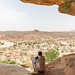Somali soldier looking at the landscape of the laas geel area, Woqooyi Galbeed, Laas Geel, Somaliland