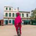 Somali woman in front of old ottoman houses, Sahil region, Berbera, Somaliland
