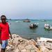 Somali boy in front of stationing boats in the port, Sahil region, Berbera, Somaliland