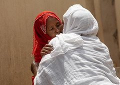 Muslim woman kissing an orthodox woman in the street, Harari region, Harar, Ethiopia (Eric Lafforgue) Tags: adultsonly africa citylife cultures dailylife day domesticlife eastafrica ethiopia ethiopia2019063 friendship harar hararjugol harer harergey horizontal hornofafrica hug kiss kissing lifestyles muslim oromia oromo orthodox outdoors peace photography realpeople street traditionalclothing traveldestination twopeople unescoworldheritagesite women womenonly harariregion