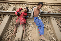 Bangladesh, street boys at a railway station in Dhaka (Dietmar Temps) Tags: abandoned asia bangladesh boy child culture developingcountry dhaka homelessness human humanity kid loneliness male orphan outdoor people person poor poverty streetchildren streetkids streetyouth young