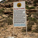 Warning billboard for tourists in the archaeological site, Woqooyi Galbeed, Laas Geel, Somaliland