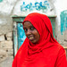 Portrait of a somali woman in red hijab in the streets of the old town, Sahil region, Berbera, Somaliland