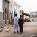 Somali men walking in the old town, Sahil region, Berbera, Somaliland