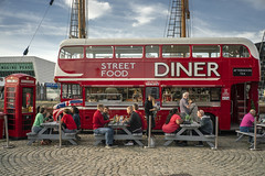 Quintessentially British (Howie Mudge LRPS BPE1*) Tags: bus doubledecker diner café cafe albertdocks liverpool england travel candid people men women red telephonebox streetfood sony sonyalphagang sonya7rii 7artisans35mmf2 sonyilce7rm2