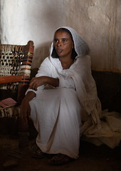 Eritrean orthodox woman in traditional clothing, Central region, Asmara, Eritrea (Eric Lafforgue) Tags: adults africa africanethnicity asmara asmera chair christianity day eastafrica eritrea eritrea190815 eritrean headscarf hornofafrica indoors lookingaway orthodox outdoors photography portrait realpeople scarf shawl sit traditionalclothing vertical white women centralregion