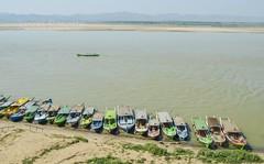 Row of Boats on bank of the Irriwaddy River, Burma (Wide View) (jasonrosette) Tags: camerado jrosette jasonrosette asia travel water shore river boats burma myanmar irriwaddy ferry riverine