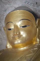 Portrait of Golden Buddha Face with Ambient Light, Bagan, Myanmar