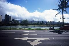 Honolulu (goodfella2459) Tags: nikonf4 afnikkor24mmf28dlens kodakelitechromeextracolor100 35mm e6 slidefilm analog colour city streets road trees sky buildings honolulu hawaii