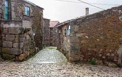 "Neighborhood of Stone _7714 (hkoons) Tags: iberianpeninsula sabugal castle""cobble stonestreet view city europe portugal antiquity architecture asphalt avenue buildings gravel highway historic history old outdoors path road stone street town village"