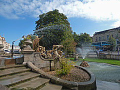 The Neptune Fountain - Promenade, Cheltenham (ell brown) Tags: cheltenham cheltenhamspa gloucestershire england unitedkingdom greatbritain spatown tree trees promenade promenadecheltenham fountain theneptunefountain portlandstone rlboulton cheltenhamboroughcouncil royscottrustplc statue sculpture gradeiilisted neptunefountainapproximately100metressouthwestofmainentrancetomunicipaloffices fountainandstatues josephhall neptunedrawnby4seahorses stgeorgesrd stgeorgesrdcheltenham