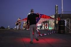 Illuminated kites (Cat Thackstone) Tags: dusk september festival sea burnham pier flying night lights with kites