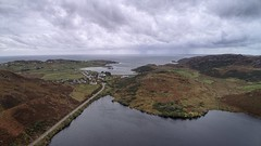Rain out to Sea (ShinyPhotoScotland) Tags: colour sky fall autumn structure landform undulating hills median imagemagick rawtherapee beautiful dramatic clouds precipitation rain sea loch rocks wild remote highlands statesofwater water aerial snapseed hdr djimavic2pro nature landscape scotland assynt scourie drone