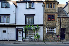 Street In Oxford (Jocelyn777) Tags: buildings architecture facades doorsandwindows flowers bicycles stones stonehouses streets oxford england