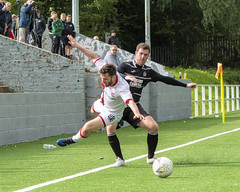 Photo of Liam Gormley earns a caution for a late challenge on Michael Bailey