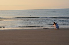 THINKING..... (Bruno Viganò) Tags: lidodijesolo jesolo beach strand alba sunrise thinking seaside adriaticsea mareadriatico seascape watersky water spiaggia cieloeacqua nikon5100 55200mm people sea woman girl