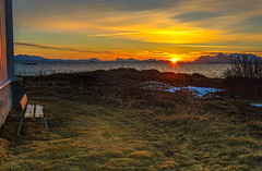 Sunset in the Vesteralen (mlk.dahoui) Tags: norway winter baltic sea ocean sun sunset sunrise colour day bench grass church horizon sky clouds light mountain fjord photography photographer nikon d750 nikonflickraward yellow landscape seascape quiet beauty beautiful colourful vesteralen polar circle cold lofoten