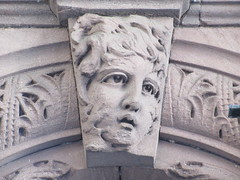 2019 Gargoyle Face above Doorway 25th St NYC 1379 (Brechtbug) Tags: 2019 gargoyle face above doorway building facade 25th street between 7th 8th avenues nyc 09152019 new york city midtown manhattan gargoyles portraits monster portrait monsters creature faces spooky art architecture sculpture keystone mask brownstone brown stone