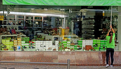Opening the Green Store - Lisbon, Portugal (TravelsWithDan) Tags: store woman candid openingthestore green colorful shoes reflections streetcar lisbon portugal europe city urban canong3x