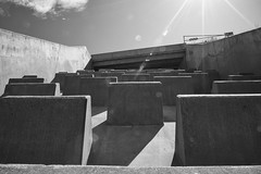 Barrier and Entry (silver_ring) Tags: bw concrete dam overflow contrast sunburst sunstar f22 24120 dusty flair
