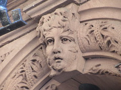 2019 Gargoyle Face above Doorway 25th St NYC 1377 (Brechtbug) Tags: 2019 gargoyle face above doorway building facade 25th street between 7th 8th avenues nyc 09152019 new york city midtown manhattan gargoyles portraits monster portrait monsters creature faces spooky art architecture sculpture keystone mask brownstone brown stone