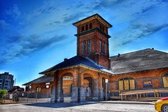 Guelph Ontario - Canada - Guelph Central Station - Heritage (Onasill ~ Bill Badzo - 66M) Tags: wentworthcounty waterloocounty rail r railroad depot train station rrd heritage historic architecture style romanesque tower viastation restored cnn guelph ont ontario canada cpr downtown passenger sky clouds blue onasill building grand trunk