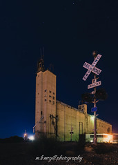brownfield elevator (m.k.mcgill) Tags: brownfield canon efs1855 lubbock southplains t5i tx texas westtexas abandoned agriculture grainelevator industrial light mkmcgillphotography mkmcgill night nightlight nightsky panoramic railroad silo smalltown stars traincrossing