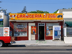 carniceria el valle. los angeles, ca, 2004. (eyetwist) Tags: eyetwistkevinballuff eyetwist carniceria meat market storefront typography losangeles nikon coolpix 8700 e8700 saturated color processed postprocessed street california urban details angeleno los angeles americana la socal reprocessed detail sharp type typographic lettering elvalle yellow bars sidewalk beef pork budlight payphone spanish centinela water gone camel red