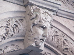 2019 Gargoyle Face above Doorway 25th St NYC 1380 (Brechtbug) Tags: 2019 gargoyle face above doorway building facade 25th street between 7th 8th avenues nyc 09152019 new york city midtown manhattan gargoyles portraits monster portrait monsters creature faces spooky art architecture sculpture keystone mask brownstone brown stone
