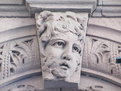 2019 Gargoyle Face above Doorway 25th St NYC 1378 (Brechtbug) Tags: 2019 gargoyle face above doorway building facade 25th street between 7th 8th avenues nyc 09152019 new york city midtown manhattan gargoyles portraits monster portrait monsters creature faces spooky art architecture sculpture keystone mask brownstone brown stone