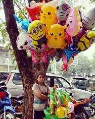 balloon seller (_gem_) Tags: instagram city street urban philippines metromanila manila quezoncity balloon vendor seller balloons cartooncharacters